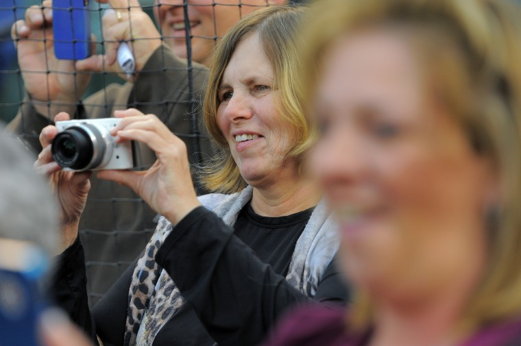 Zill's wife Trudy records the first pitch ceremony with a camera