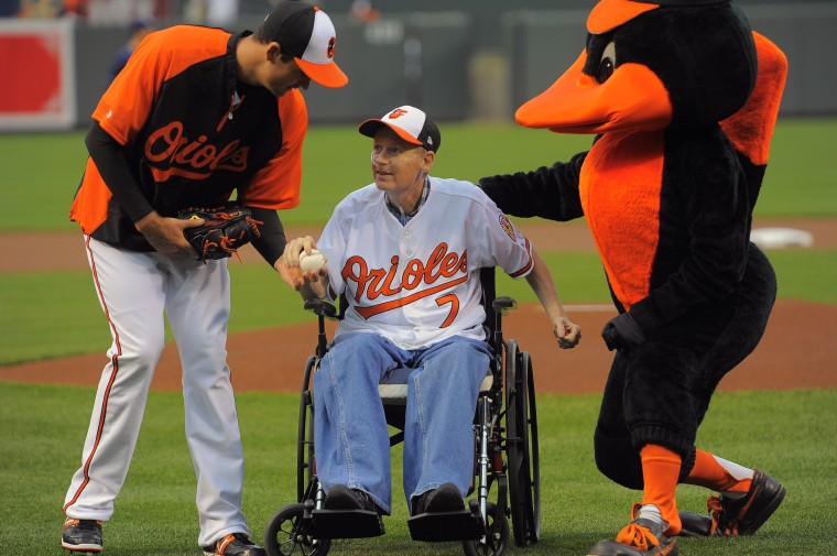 Zill, in wheelchair, acknowledge by pitcher T.J. McFarland and The Bird mascot after first pitch