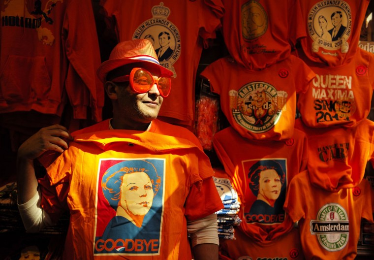 A man wearing shades displays a t-shirt depicting Dutch Queen Beatrix in a souvenirs shop in Amsterdam April 29, 2013. The Netherlands is preparing for Queen's Day on April 30, which will also mark the abdication of Queen Beatrix and the investiture of her eldest son Willem-Alexander. (Cris Toala Olivares/Reuters)