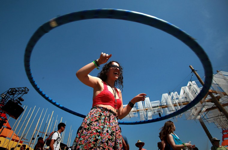 Phenia Hovsepyan, 23, of Los Angeles, hula hoops at the Coachella Music & Arts Festival on Friday, April 12, 2013, in Indio, California. (Brian van der Brug/Los Angeles Times/MCT Photo)