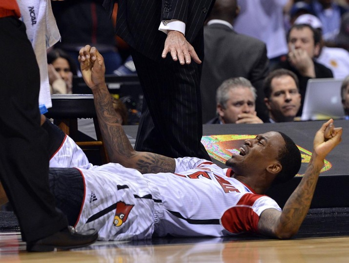 Louisville head coach Rick Pitino tells guard Kevin Ware (5) to stay down after he broke his leg in front of the bench in the first half of the NCAA Tournament at Lucas Oil Stadium in Indianapolis, Indiana, Sunday, March 31, 2013. Louisville defeated Duke, 85-63. (Chuck Liddy/Raleigh News & Observer/MCT