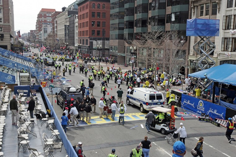 Emergency personnel assist the victims at the scene of a bomb blast during the Boston Marathon in Boston, Massachusetts, Monday, April 15, 2013. (Stuart Cahill/Boston Herald/MCT)