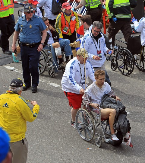 Victims of the bomb blast during the Boston Marathon are assisted in Boston, Massachusetts, Monday, April 15, 2013. (Stuart Cahill/Boston Herald/MCT)