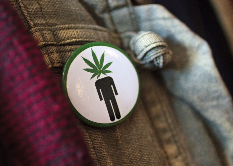 "Frank Nuccio wears a ""pothead"" button on his jacket while attending a cannabis cooking class in Denver, Colorado, on Thursday, April 18, 2013. (Werner R. Slocum/MCT Photo)"