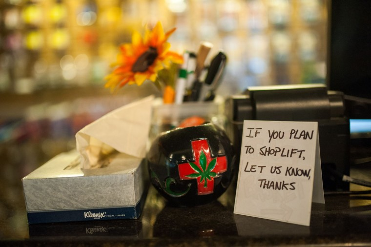 A sign requests that would-be shoplifters identify themselves on a small sign seen here in the at Ganja Gourmet in Denver, Colorado, on April 17, 2013. (Dustin Bradford/MCT Photo)