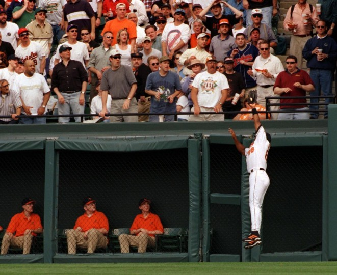 Cleveland Indians vs. Baltimore Orioles at Camden Yards on Opening Day. Oriole Albert Belle jumps up to make the catch on a fly ball. (Karl Merton Ferron/Baltimore Sun)