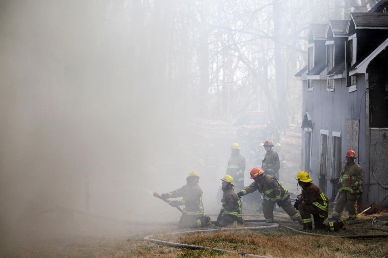 Howard County Fire Department trainees work with instructors during a controlled burn on Weavers Court in Ellicott City, MD on April 9, 2013. (Jen Rynda/Patuxent Publishing)