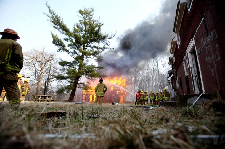 A house goes up in flames during a controlled burn on Weavers Court in Ellicott City, MD on April 9, 2013. (Jen Rynda/Patuxent Publishing)