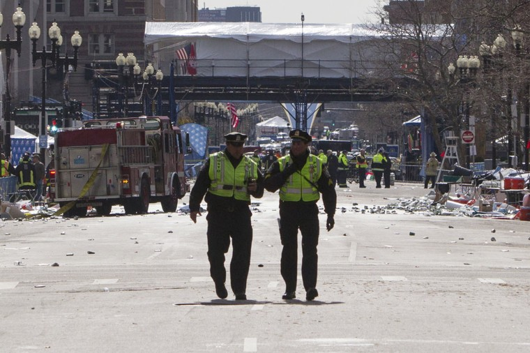 Boston police officers patrol down Boylston Street near the scene of multiple explosions near the end of the Boston Marathon finish line in Boston, Massachusetts April 15, 2013. Two explosions hit the Boston Marathon as runners crossed the finish line on Monday, killing at least two people and injuring 23 on a day when tens of thousands of people pack the streets to watch one of the world's best known marathons. (Scott Eisen/Reuters photo)