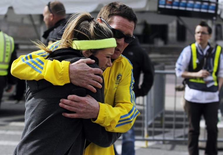A woman is comforted by a man near a triage tent set up for the Boston Marathon after explosions went off at the 117th Boston Marathon in Boston, Massachusetts April 15, 2013. (Jessica Rinaldi/Reuters photo)