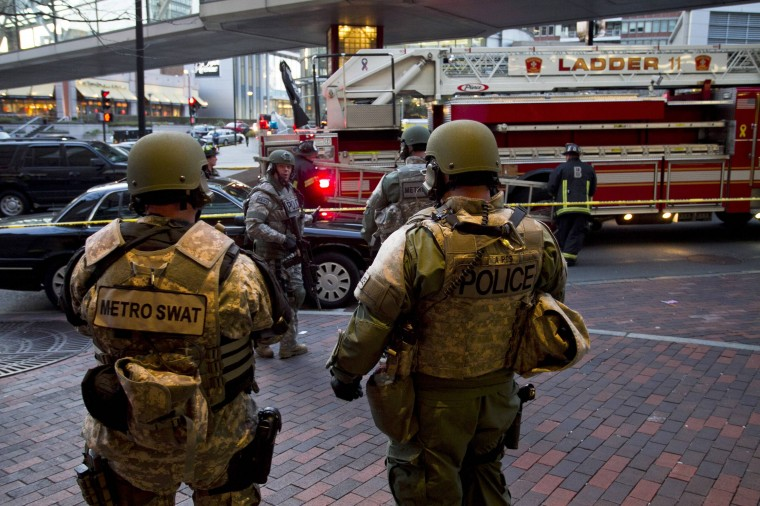 """SWAT officers stand guard after two explosions interrupted the running of the Boston Marathon in Boston, Massachusetts April 15, 2013. Two bombs ripped through the crowd at the finish line of the Boston Marathon on Monday, killing two people and injuring dozens in what a White House official said would be handled as an """"act of terror."""" (Dominick Reuter/Reuters photo)"""