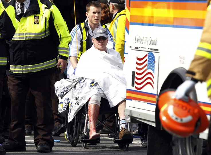 A runner in a wheelchair is taken from a triage tent after explosions went off at the 117th Boston Marathon in Boston, Massachusetts April 15, 2013. Two explosions hit the Boston Marathon as runners crossed the finish line on Monday, killing at least two people and injuring 23 on a day when tens of thousands of people pack the streets to watch one of the world's best known marathons. (Jessica Rinaldi/Reuters photo)