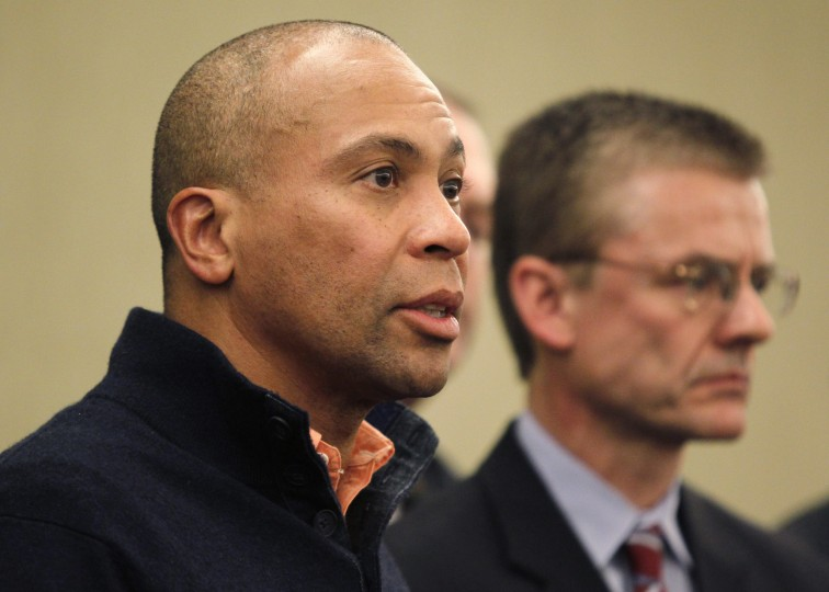 Massachusetts Governor Deval Patrick, left, speaks to reporters alongside FBI Special Agent in Charge in Boston Richard DesLauriers during a news conference held to discuss the explosions at the Boston Marathon in Boston, Massachusetts April 15, 2013. (Jessica Rinaldi/Reuters photo)