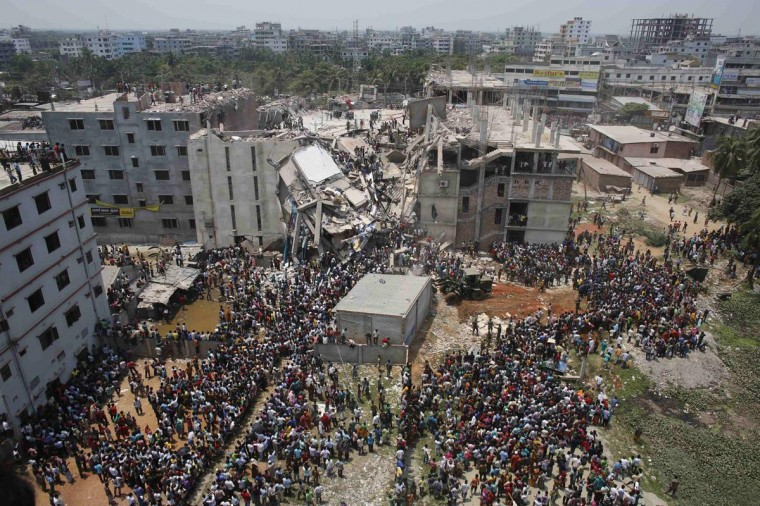 Crowds gather at the collapsed Rana Plaza building as people rescue garment workers trapped in the rubble, in Savar, 19 miles outside Dhaka April 24, 2013. The eight-storey block housing garment factories and a shopping centre collapsed on the outskirts of the Bangladeshi capital on Wednesday, killing at least 25 people and injuring more than 500, the Ntv television news channel reported. (Andrew Biraj/Reuters)