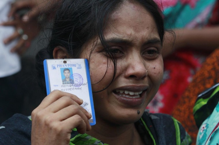 Johura, 20, holds a picture of her missing husband Motiur Rahman, a garment worker who was working in the Rana Plaza building when it collapsed, in Savar, 19 miles outside Dhaka April 24, 2013. The eight-storey block housing factories and a shopping centre collapsed on the outskirts of the Bangladeshi capital on Wednesday, a government official said. (Andrew Biraj/Reuters)