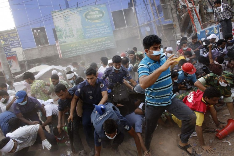 Rescue workers, army personnel, police and members of media run after they heard someone shouting that a building next to Rana Plaza is collapsing during a rescue operation in Savar, 19 miles outside Dhaka April 26, 2013. The search for survivors from Bangladesh's worst industrial accident stretched into a third day on Friday, with the death toll rising to 273 after the collapse of Rana Plaza. (Andrew Biraj/Reuters)