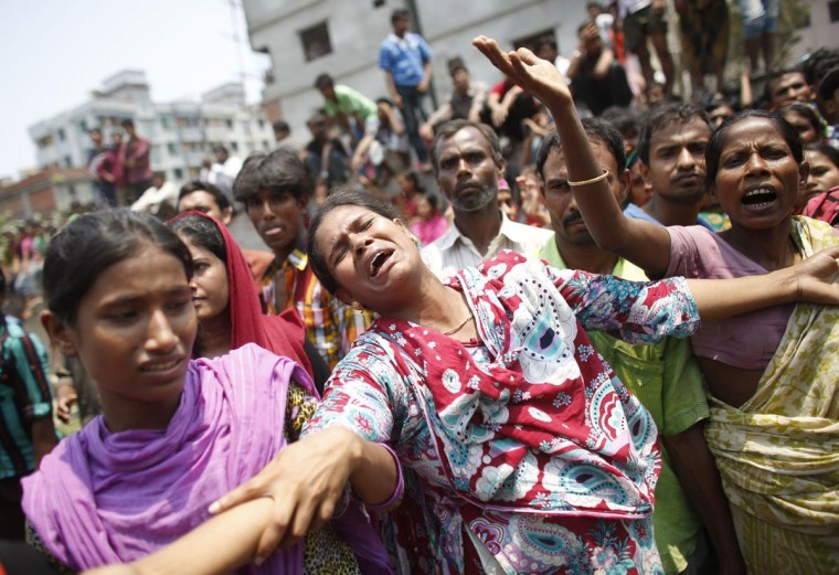 People mourn for their relatives, who were working in the Rana Plaza building when it collapsed, in Savar, 19 miles outside Dhaka April 24, 2013. The eight-storey block housing factories and a shopping centre collapsed on the outskirts of the Bangladeshi capital on Wednesday, a government official said. (Andrew Biraj/Reuters)