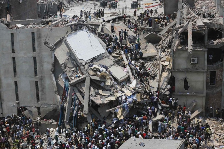 People rescue garment workers trapped under rubble at the Rana Plaza building after it collapsed, in Savar, 19 miles outside Dhaka April 24, 2013. An eight-storey block housing garment factories and a shopping centre collapsed on the outskirts of the Bangladeshi capital on Wednesday. (Andrew Biraj/Reuters)