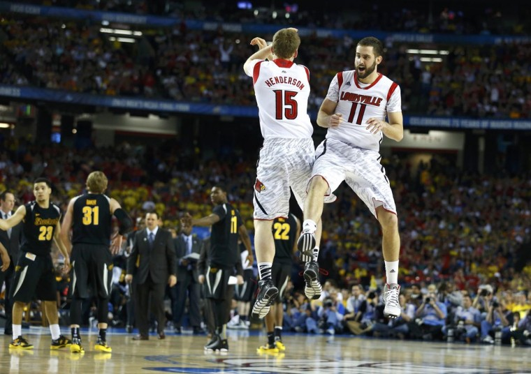 Louisville Cardinals guard/forward Luke Hancock (R) and teammate guard Tim Henderson celebrate near the end of their NCAA men's Final Four basketball game against the Wichita State Shockers in Atlanta, Georgia April 6, 2013. (Chris Keane/Reuters)