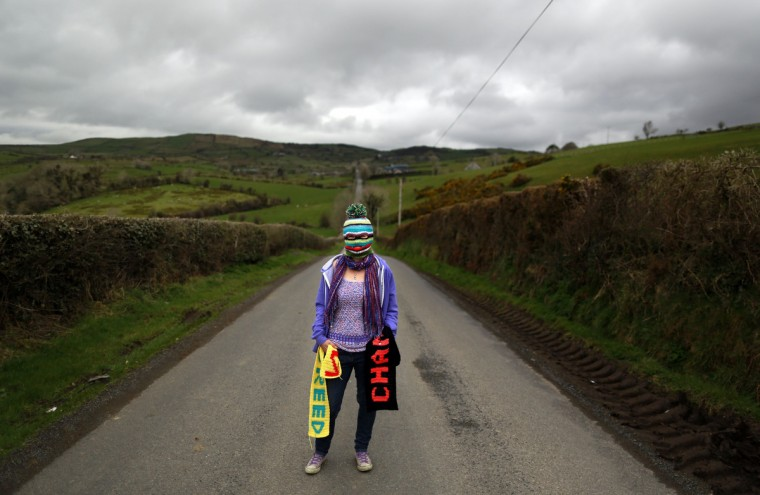 A woman known as Purl 1, 47, originally from Essex and part of a group of 'yarnbombers' based in the rural South Down, poses near the Mourne Mountains in County Down, Northern Ireland. The group is planning to target the June 17-18 G8 summit in Enniskillen with yarnbombing, a type of graffiti using knitted or crocheted yarn or fibre. (Cathal McNaughton/Reuters photo)