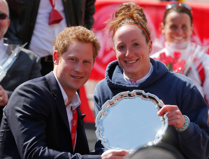 Tatyana McFadden of Clarksville, Md. poses with Britain's Prince Harry after winning the women's wheelchair race. (Getty Images)