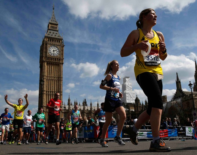 Runners pass the Houses of Parliament during the London Marathon in central London. (Eddie Keogh/Reuters)