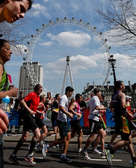 Runners pass the London Eye. (/Eddie Keogh/Reuters)