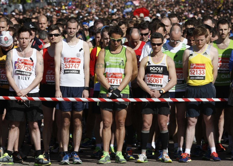 Runners observe a moment of silence before the start of the London Marathon. (Luke MacGregor/Reuters)