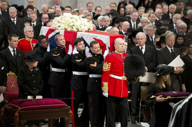 Britain's Queen Elizabeth (front L) and Mark Thatcher (R), son of former British prime minister Margaret Thatcher, watch as her coffin arrives in St Paul's Cathedral for the funeral service, in London. (Paul Edwards/Reuters)