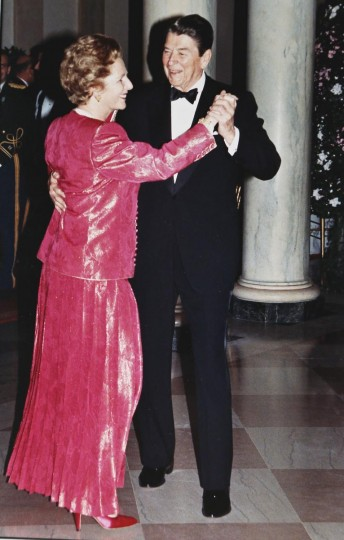 President Ronald Reagan and Prime Minister Margaret Thatcher take a spin around the dance floor in the foyer of the White House during a State Dinner in the Prime Minister's honor in this November 16, 1988, file photo. The state dinner for Thatcher was the 55th and final state dinner of the Reagan presidency and was a bookend to the Reagan's first state dinner in February 1981 which also honored Prime Minister Thatcher. (Larry Rubenstein/Reuters Files)