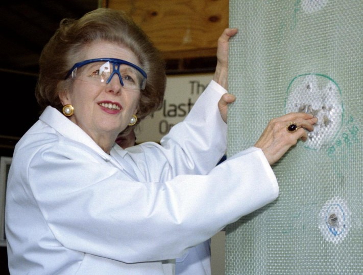 Baroness Thatcher examines a sheet of bullet-proof material during a visit to a factory producing ballistic and blast protection products in this April 9, 1997 file photo. (Michael Crabtree/Reuters Files)