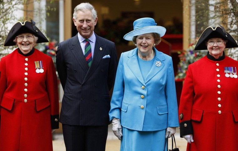 Britain's Prince Charles (2nd L) and former Prime Minister Margaret Thatcher (2nd R) pose with Chelsea pensioners Dorothy Hughes (L) and Winifred Phillips as they attend the opening of a new infirmary at the Royal Hospital Chelsea in London in this March 25, 2009 file photo. (Andrew Winning/Reuters Files)