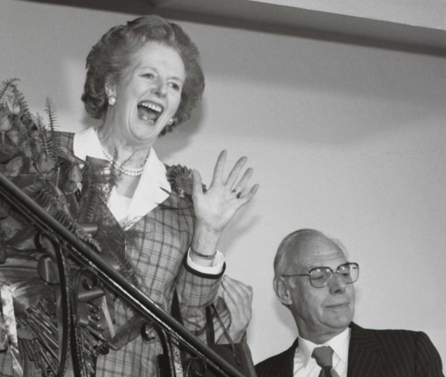 Britain's Prime Minister Margaret Thatcher gives a jubilant wave from the stairs inside her Conservative party headquarters in London early in this June 12, 1987 file photo, after sweeping back to power for a third consecutive term of office after the general election. (John Eggitt/Reuters Files)