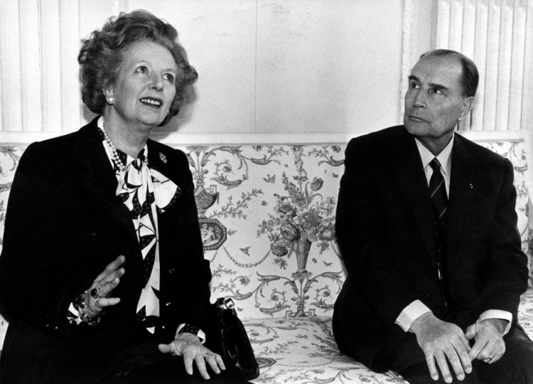 British Prime Minister Margaret Thatcher (L) and French President Francois Mitterrand talk to the media before a meeting about nuclear arms control at the Chateau de Benouville in Normandy, western France in this March 23, 1987 file photo. (Charles Platiau/Reuters Files)