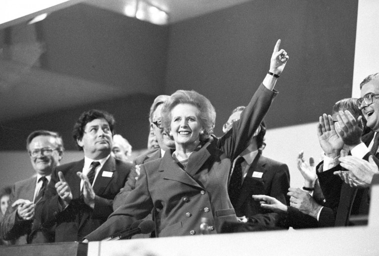Then British Prime Minister Margaret Thatcher points skyward as she receives standing ovation at Conservative Party Conference in this October 13, 1989 file photo. (Stringer/Reuters Files)