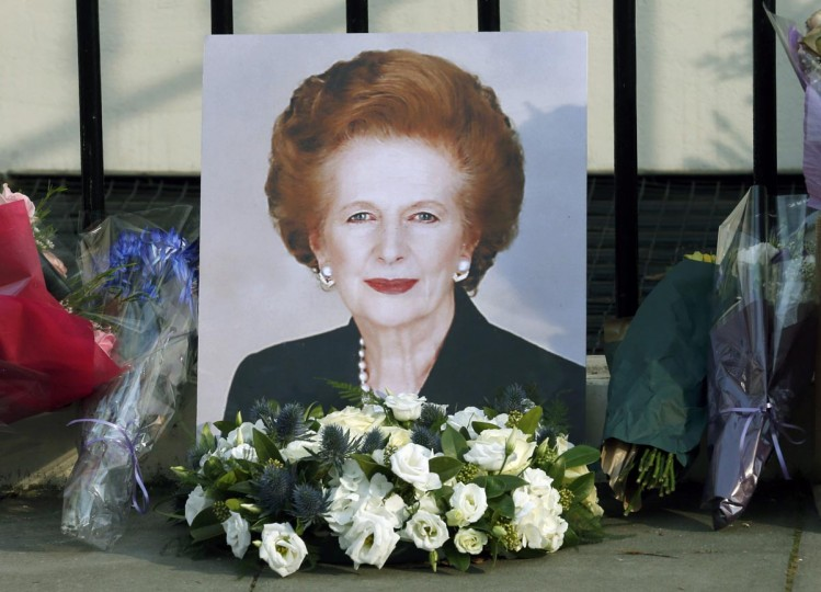 "A portrait left by mourners is seen outside the home of former British prime minister Margaret Thatcher after her death was announced in London April 8, 2013. Margaret Thatcher , the ""Iron Lady"" who transformed Britain and inspired conservatives around the world by radically rolling back the state during her 11 years in power, died on Monday following a stroke. She was 87. (Suzanne Plunkett/Reuters)"