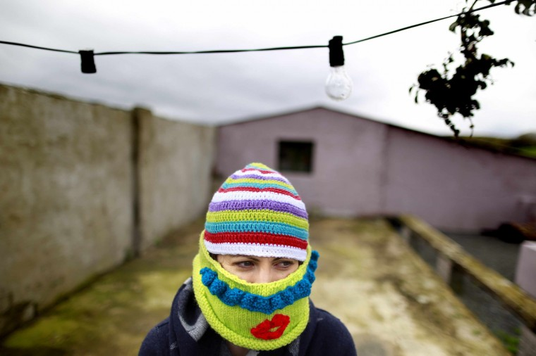 A woman known as Purl 6, 31, originally from Newcastle and part of a group of 'yarnbombers' based in the rural South Down, poses near the Mourne Mountains in County Down, Northern Ireland. The group is planning to target the June 17-18 G8 summit in Enniskillen with yarnbombing, a type of graffiti using knitted or crocheted yarn or fibre. (Cathal McNaughton/Reuters photo)