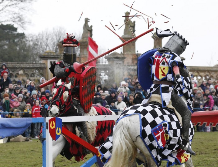 Performers dressed as medievel knights joust at Knebworth House in Hertfordshire April 1, 2013. Knebworth House, a stately home of the Lytton family since 1490, hosted The Knights Of Royal England in their first medievel jousting tournament of the season. (Olivia Harris/Reuters)