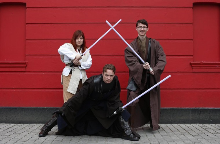 Science fiction enthusiasts Alice Di Trolio (L), Martin Comber (C) and John Gumley-Mason, dressed as characters from Star Wars, pose for a photograph outside the 12th annual Sci-Fi London festival in east London April 28, 2013. The international festival of science fiction and fantasy film runs from April 30-May 6. (Suzanne Plunkett /Reuters)