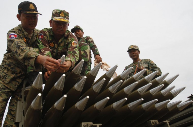 Cambodian soldiers prepare to test fire the BM-21, a multiple rocket launcher, during training at a military base in Kampong Speu province April 2, 2013. (Samrang Pring/Reuters)