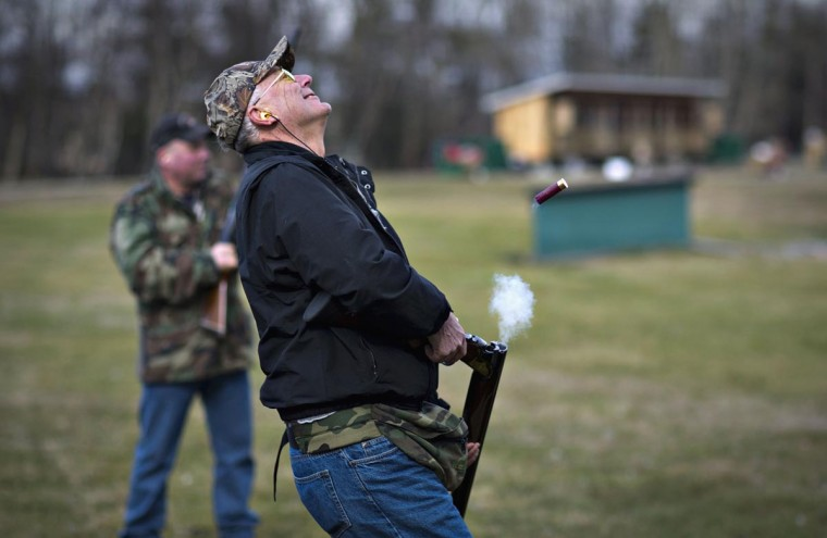 Rich Korbus reacts after missing his shot while trap shooting at the Vancouver Gun Club in Richmond, British Columbia February 17, 2013. (Andy Clark/Reuters)