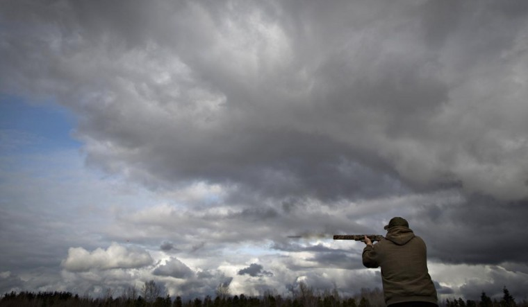 A member of the Vancouver Gun Club shoots trap at the clubs facilities in Richmond, British Columbia February 17, 2013. (Andy Clark/Reuters)