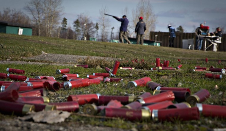 The ground is littered with spent shotgun shells at the Vancouver Gun Club in Richmond, British Columbia February 10, 2013. (Andy Clark/Reuters)
