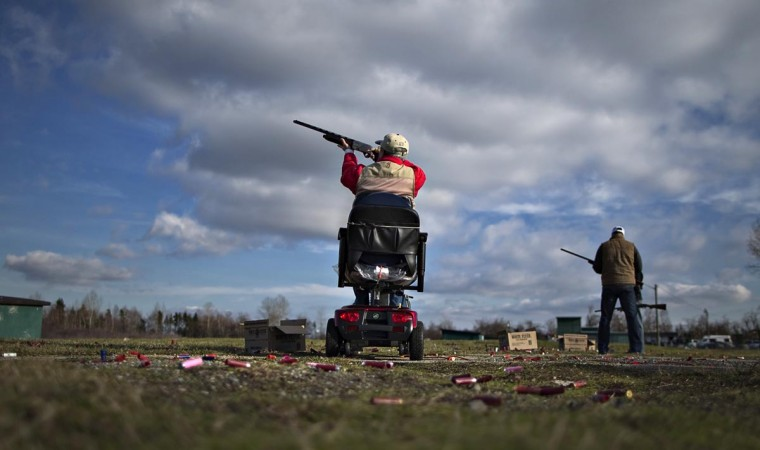 A member of the Vancouver Gun Club takes aim while trap shooting at their facility in Richmond, British Columbia February 10, 2013. (Andy Clark/Reuters)