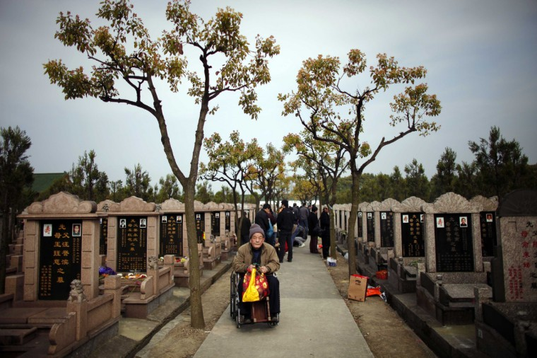 An elderly man sits on a wheelchair as he visits a cemetery during Qingming Festival, or Tomb Sweeping Day, at Songhe graveyard, on the outskirts of Shanghai. The festival, which falls on April 4 this year, is a day for the Chinese to remember and honor their ancestors. (Carlos Barria/Reuters photo)