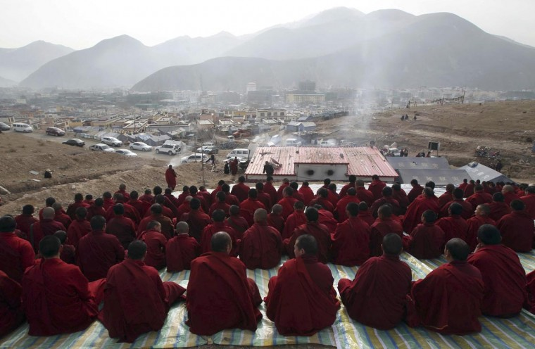 Tibetan Buddhist monks attend a mass prayer in memorial for victims of the earthquake which hit Yushu county three years ago, in Yushu, Qinghai province April 14, 2013. The 7.1-magnitude earthquake that jolted Yushu of northwest China's Qinghai Province three years ago caused 2,698 people dead and 270 missing. Picture taken April 14, 2013. (Stringer/Reuters)
