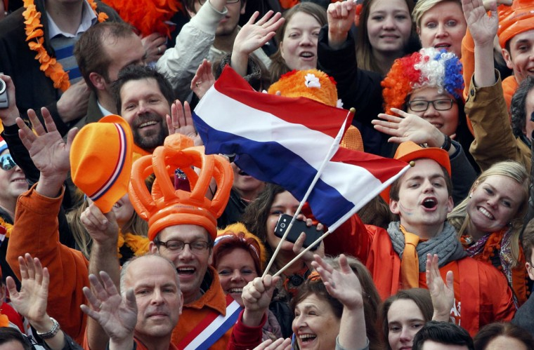 People celebrate the new Dutch King Willem-Alexander who succeeds his mother Queen Beatrix, in Amsterdam's Dam Square Queen Beatrix of the Netherlands abdicated on Tuesday, handing over to her eldest son, Willem-Alexander, who became the first King of the Netherlands in over 120 years. (Kevin Coombs/Reuters)
