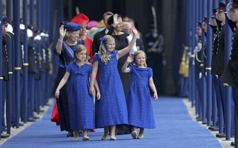 Netherlands Princess Beatrix follows the granddaughters Crown Princess Catharina-Amalia (center) Princess Alexia (left) and Princess Ariane on their way out from the Nieuwe Kerk church in Amsterdam after before the religious crowning ceremony. (Jasper Juinen/Pool/Reuters)