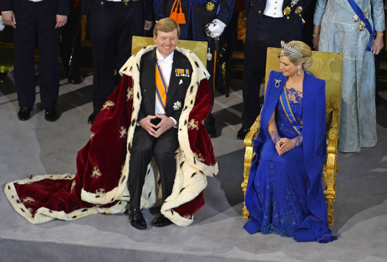 Dutch King Willem-Alexander accompanied by his wife Queen Maxima attends a religious ceremony at the Nieuwe Kerk church in Amsterdam. (Odd Anderson/Pool/Reuters)