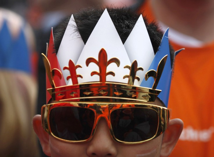 A man wears a crown during the celebrations for the new Dutch King Willem-Alexander who succeeds his mother Queen Beatrix, in Amsterdam's Dam Square. Queen Beatrix of the Netherlands abdicated on Tuesday, handing over to her eldest son, Willem-Alexander, who became the first King of the Netherlands in over 120 years. (Cris Toala Olivares/Reuters)